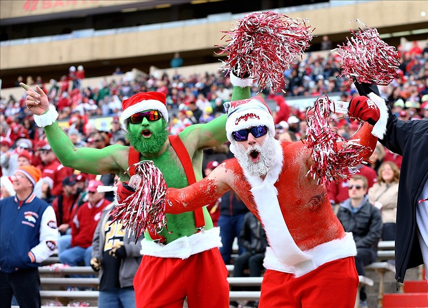dec 21 2013 albuquerque nm usa washington state cougars fans dressed up as santa claus and the grinch cheer against the colorado state rams during the - Football Christmas Eve